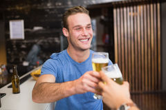 Young man toasting with pint of beer Royalty Free Stock Photos