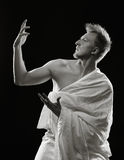 Young man and toga Royalty Free Stock Photos