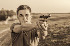 Young man took aim with pistol Royalty Free Stock Image