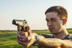 Young man took aim with pistol Royalty Free Stock Images