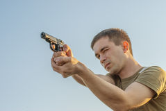 Young man took aim with pistol Royalty Free Stock Photo