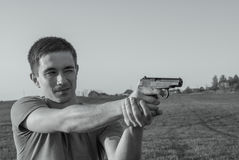 Young man took aim with pistol Stock Photo