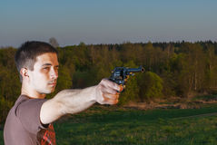 Young man took aim with pistol Royalty Free Stock Photography