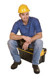 Young man tool. Isolated young caucasian man tool sit on toolbox Royalty Free Stock Photo