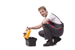 The young man with toolkit toolbox isolated on white Stock Photography