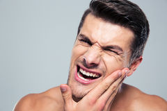 Young man with a toothache Stock Photo