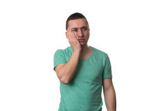 Young Man With A Toothache On White Background Stock Images