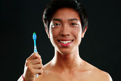 Young man with toothbrush Royalty Free Stock Photos