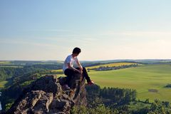 Young man on top of rock. Czech republic Royalty Free Stock Image
