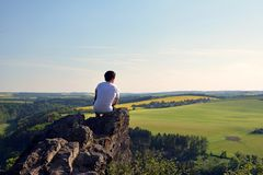 Young man on top of rock. Czech republic Stock Photo