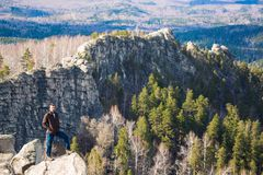 Young man on the top of the rock. Stock Image