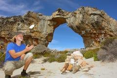 Young man tosses a rock Stock Photos