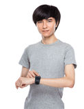Young man touch on smartwatch Stock Image
