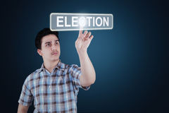 Young man touching election button Royalty Free Stock Images