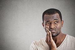 Young man touching face having really bad pain tooth ache Royalty Free Stock Image