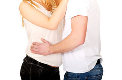 Young man touching his wife pregnancy belly stock photos