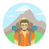 Young man tourist with a backpack on a background of mountains Royalty Free Stock Photos