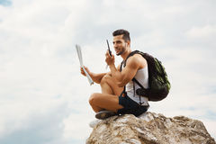 Young man tourist with a backpack Royalty Free Stock Images