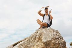 Young man tourist with a backpack Stock Photography