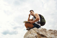 Young man tourist with a backpack Royalty Free Stock Photography