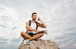 Young man tourist with a backpack Stock Image