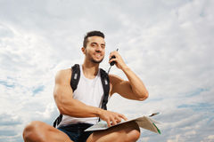 Young man tourist with a backpack Stock Photos