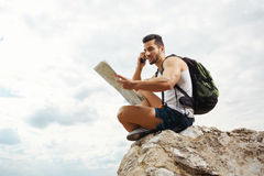 Young man tourist with a backpack Royalty Free Stock Photo