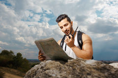 Young man tourist with a backpack Royalty Free Stock Photos