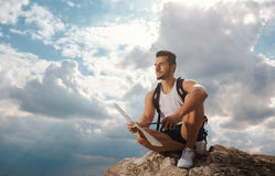 Young man tourist with a backpack Stock Images