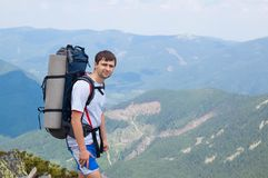 Young man tourist on a mountain in the Carpathians Royalty Free Stock Images