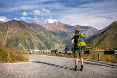 Young man tourist in the mountains Royalty Free Stock Images