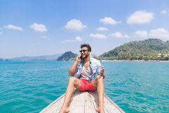 Young Man Tourist Sail Long Tail Thailand Boat Speak Cell Smart Phone Call Ocean Sea Vacation Travel Trip Royalty Free Stock Photos