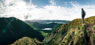 Young Man Tourist standing overlooking at Picturesque view of the Lake of Sete Cidades Seven Cities Lake , a volcanic
