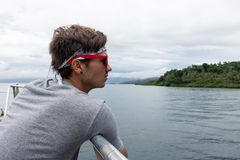 Young Man Tourist Wearing Sunglasses and Bandana Sightseeing fro stock images