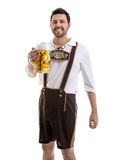 Young man in traditional bavarian costume on white background Stock Image