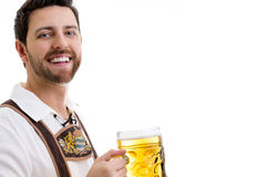Young man in traditional bavarian costume on white background Royalty Free Stock Photography