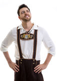 Young man in traditional bavarian costume on white background Stock Photography