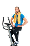 Young man train with fitness machine Stock Photo