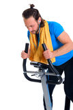 Young man train with fitness machine Royalty Free Stock Photos