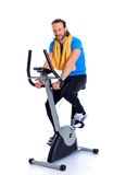 Young man train with fitness machine Royalty Free Stock Photo