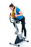 Young man train with fitness machine. In front of white background royalty free stock photography