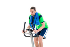 Young man train with fitness machine Royalty Free Stock Photography