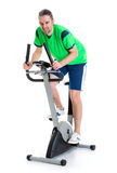 Young man train with fitness machine Royalty Free Stock Images