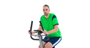 Young man train with fitness machine. Young man in green shirt train with fitness machine royalty free stock photos