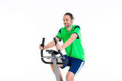 Young man train with fitness machine and listening music Stock Photo