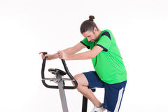 Young man train with fitness machine Stock Image