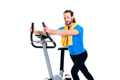 Young man train with fitness machine. Young man warming up for train with fitness machine royalty free stock photo