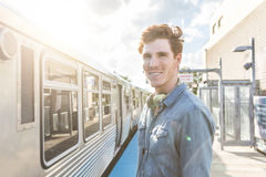Young man at train station in Chicago Stock Images