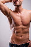 Young man trained topless with abs Stock Photography