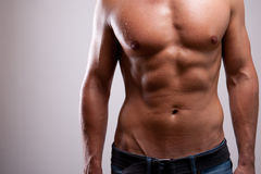 Young man trained topless with abs Royalty Free Stock Image